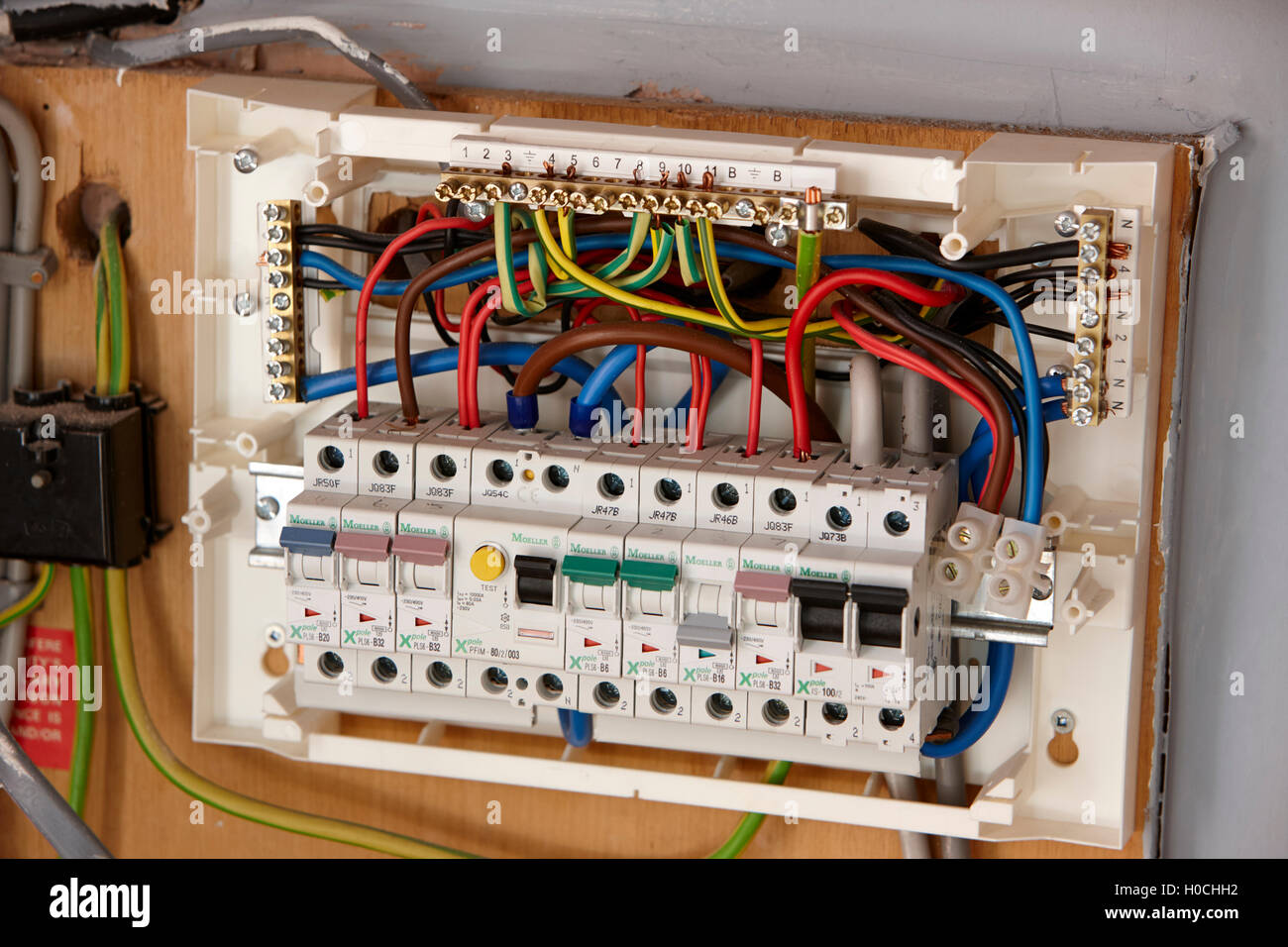 exposed wiring in domestic consumer unit circuit breaker in the uk - stock  image