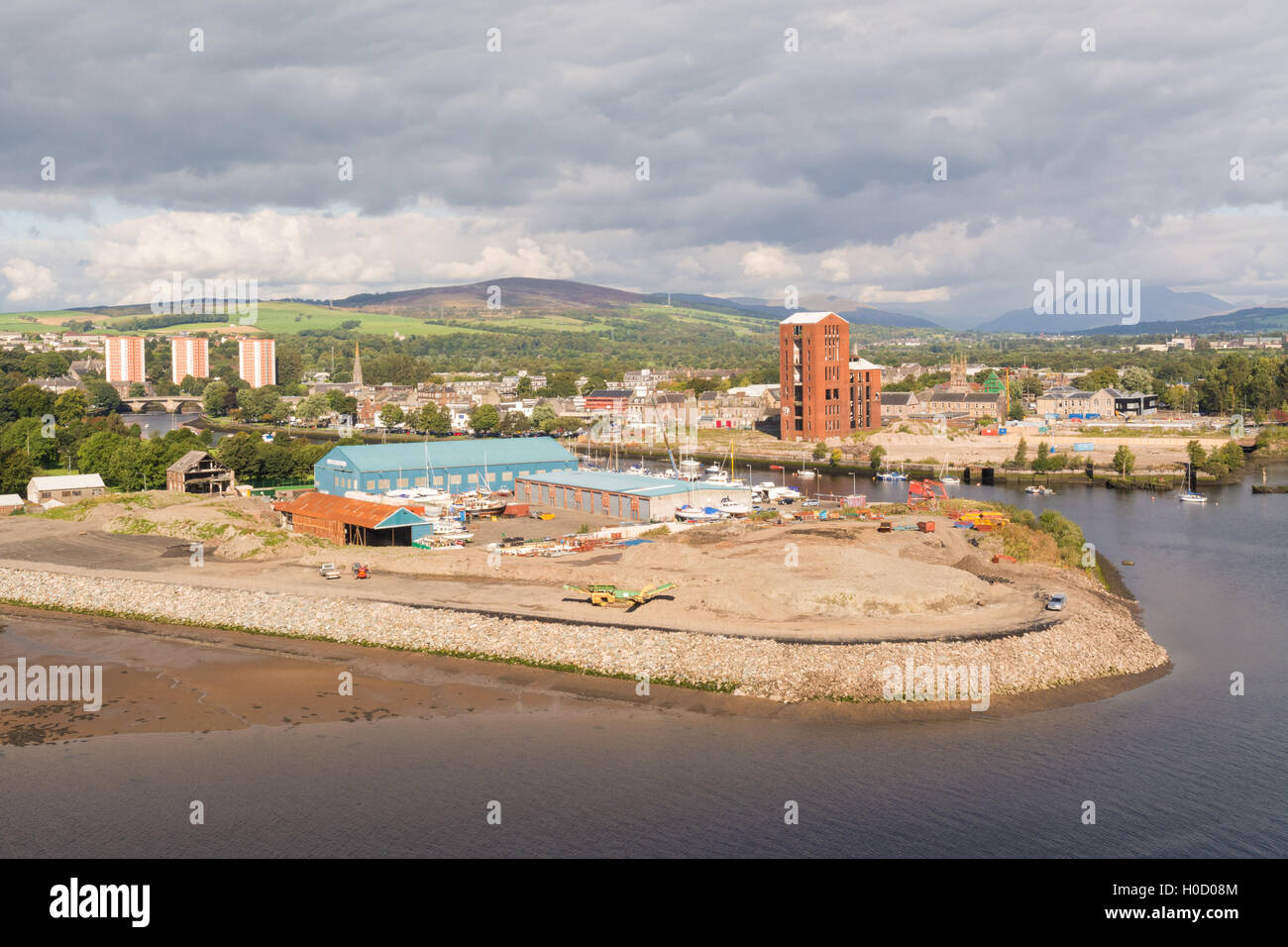 Dumbarton city centre and waterfront along the River Leven and River Clyde, whisky distillery still tower & - Stock Image