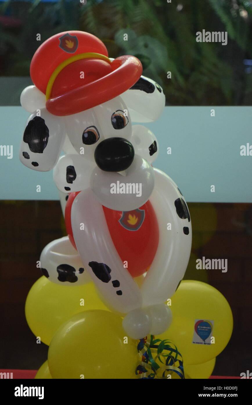 Paw Patrol birthday party balloon twisting - Stock Image