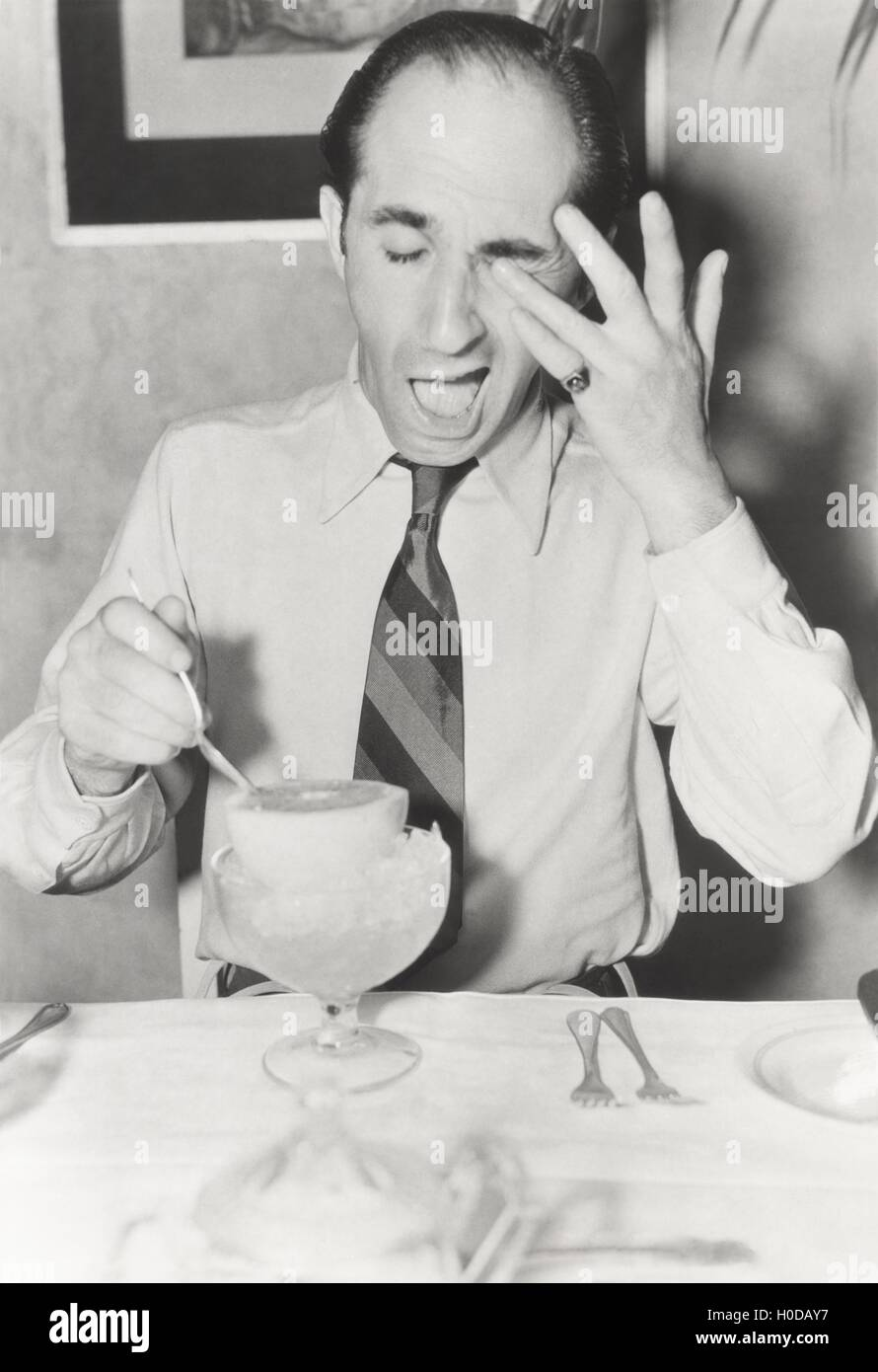 Man squirted by grapefruit - Stock Image