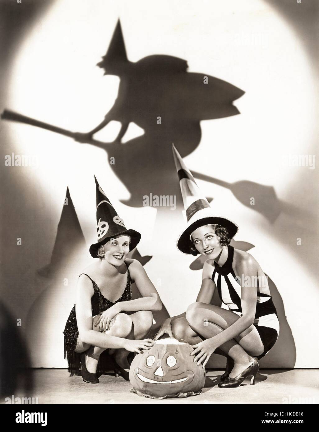 Two women celebrate a bewitching Halloween - Stock Image