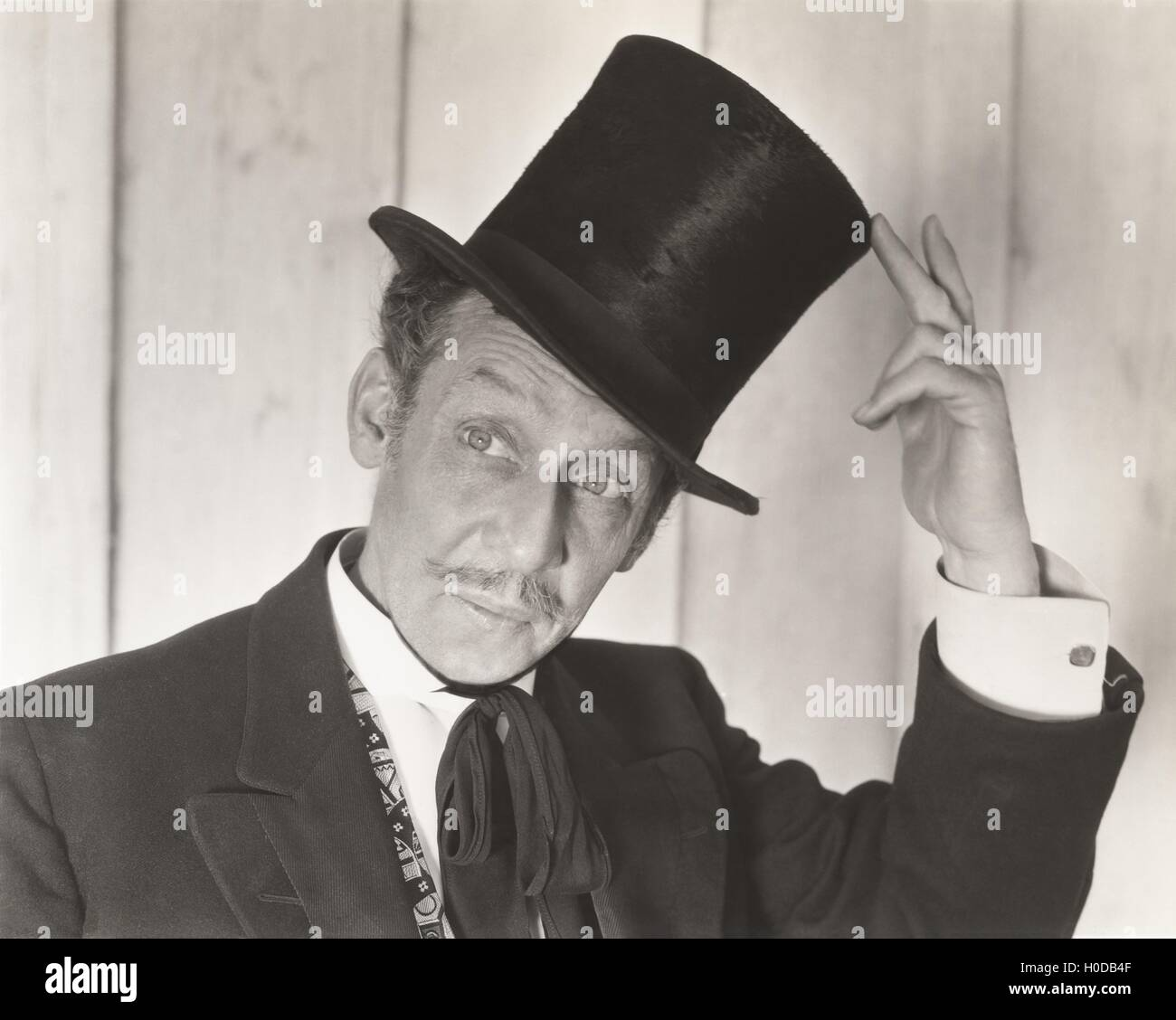 Gentleman tipping his hat Stock Photo