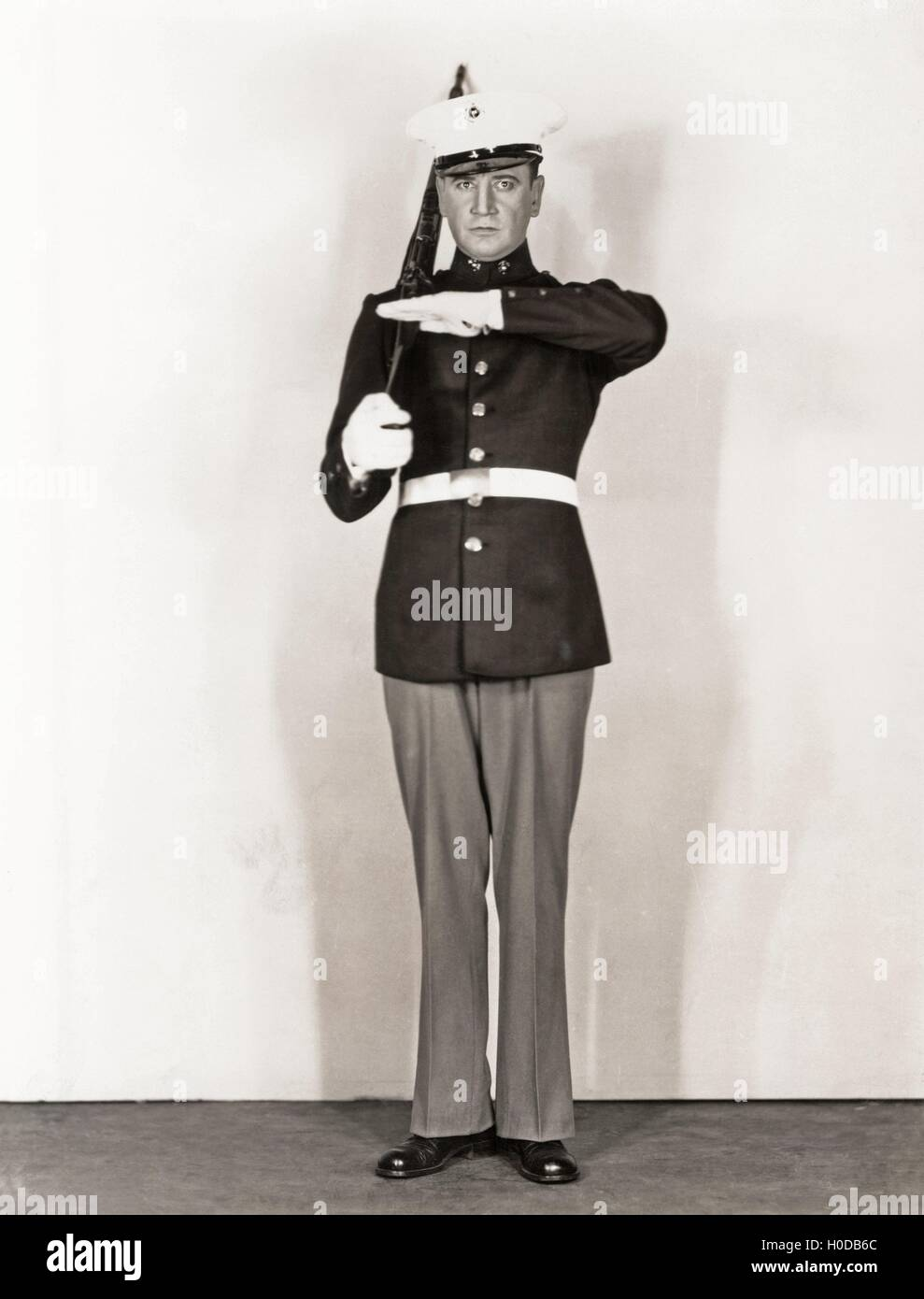 Full length portrait of marine standing at attention - Stock Image
