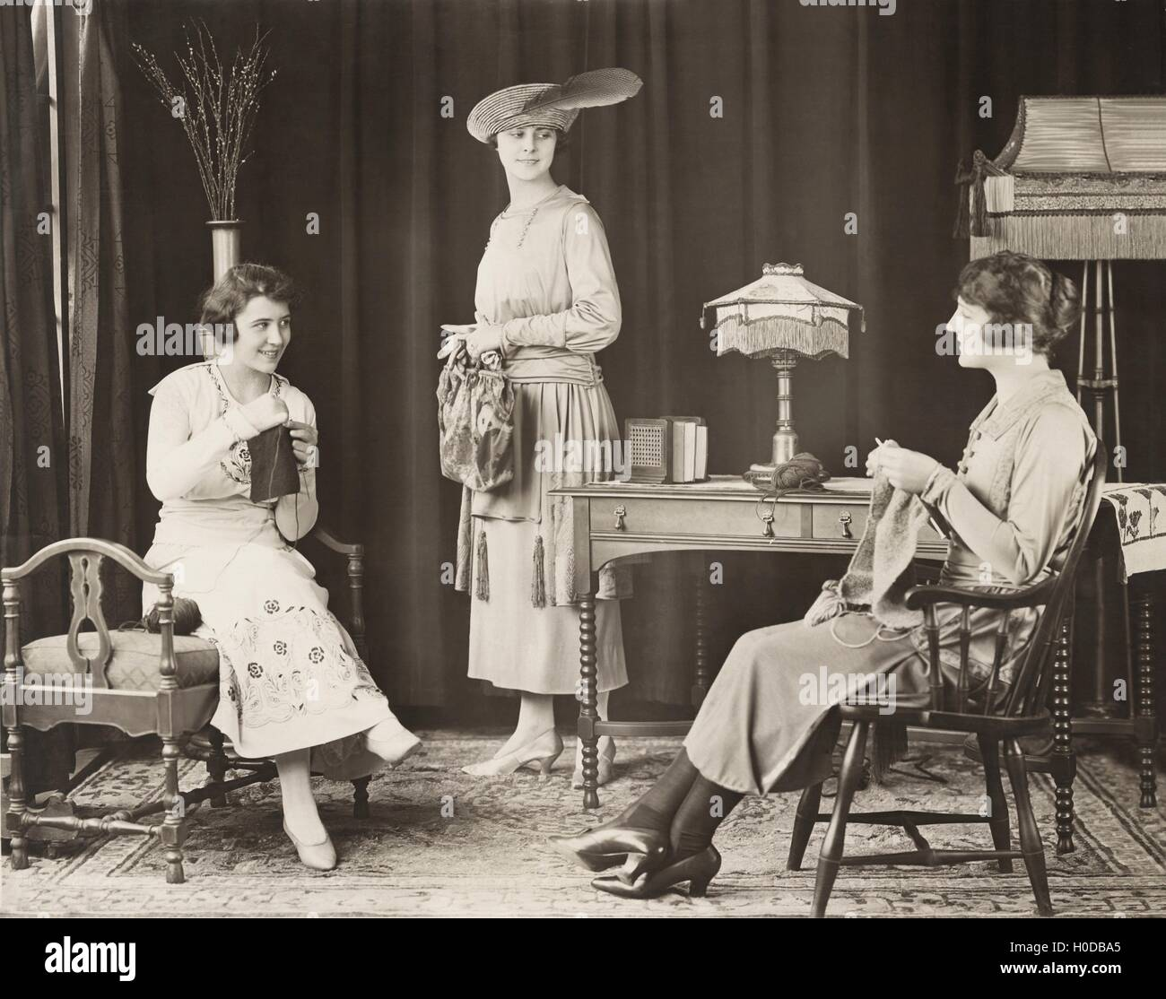 Young women knitting at home Stock Photo
