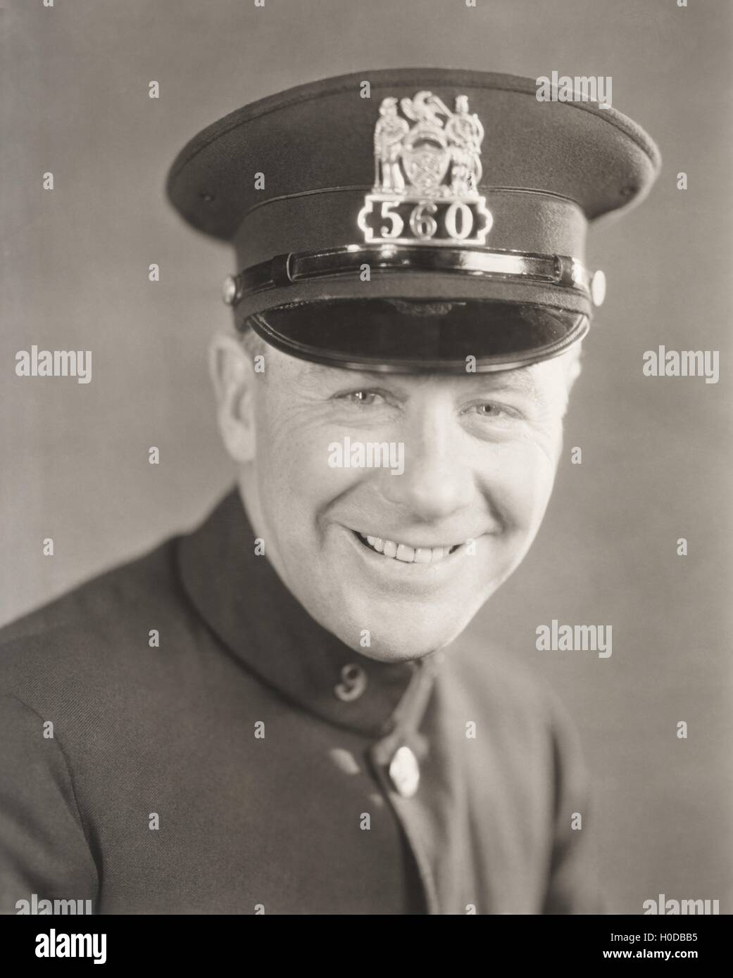 Portrait of a smiling policeman - Stock Image