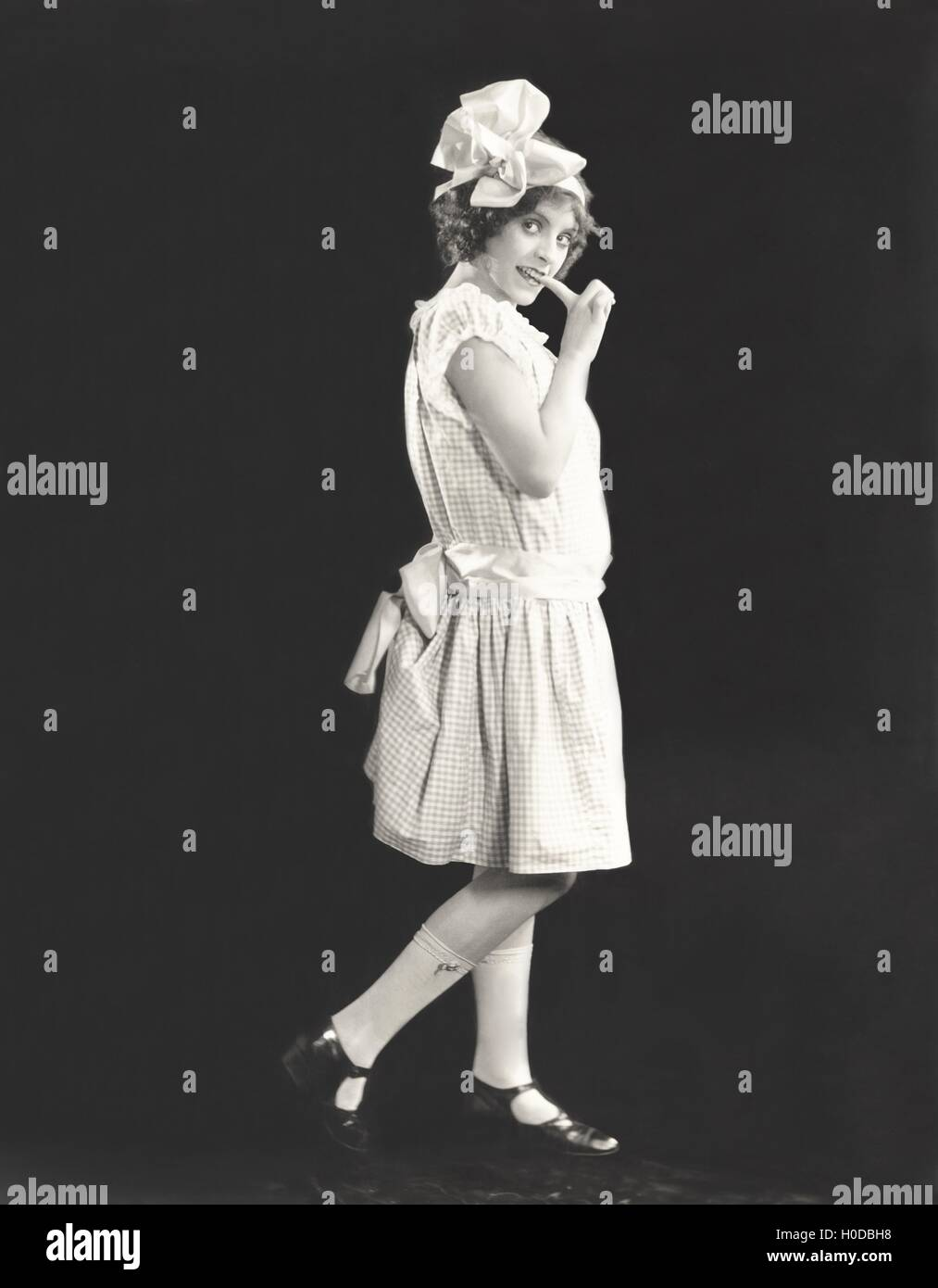Side view of shy woman - Stock Image
