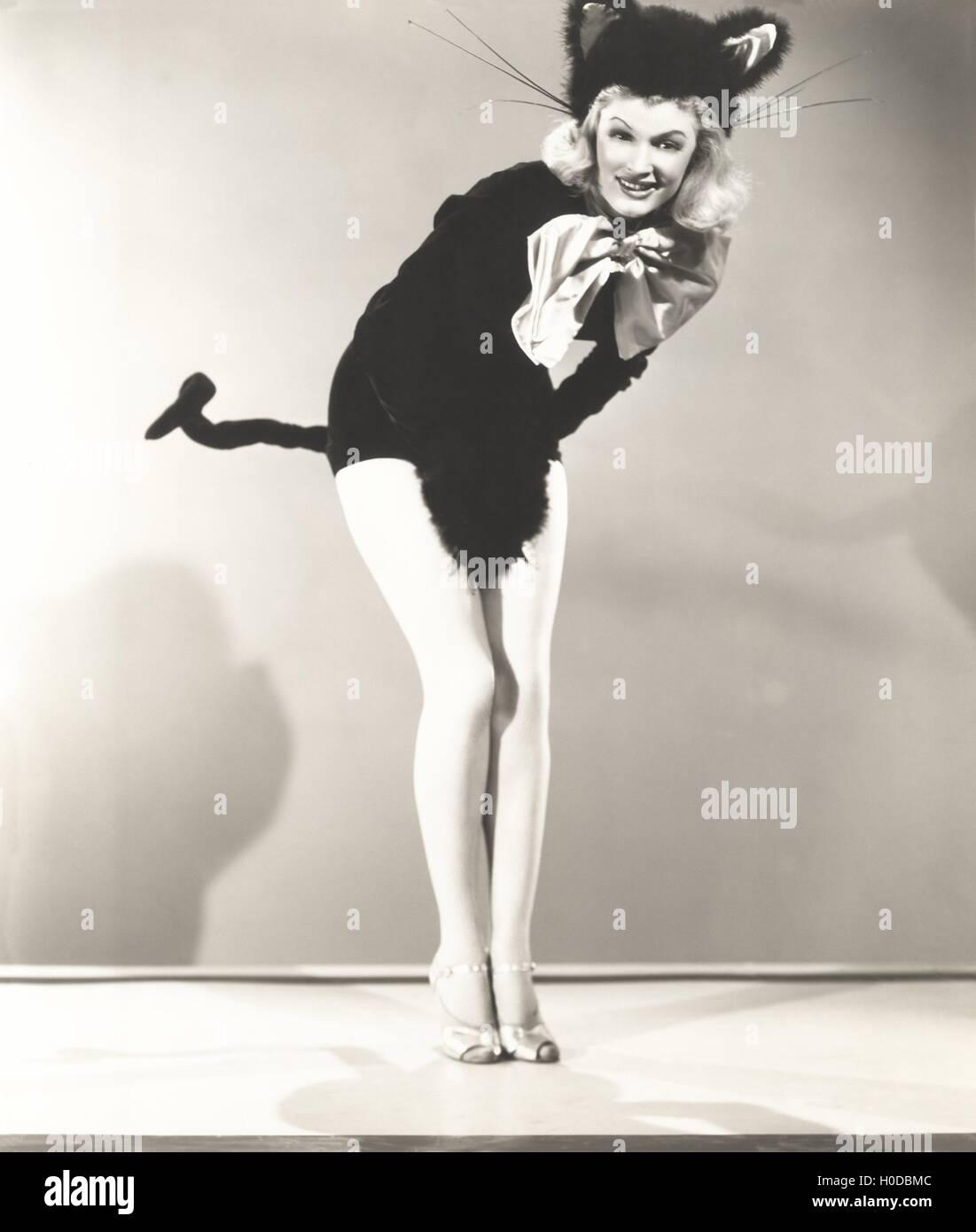 Woman wearing cat costume - Stock Image