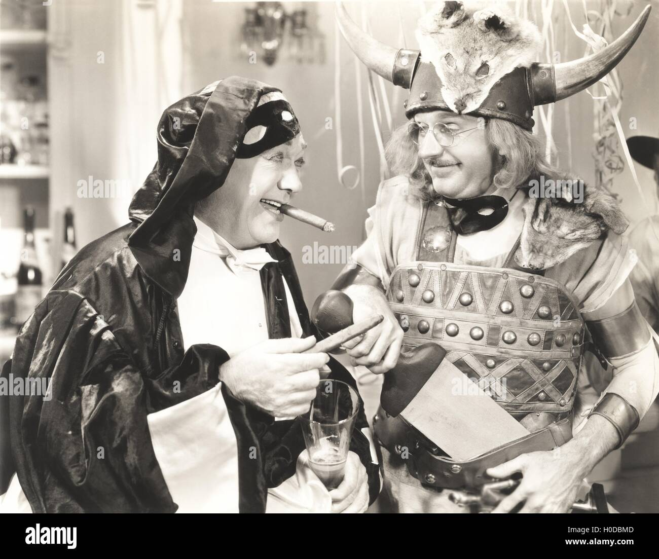 Two men at a costume party - Stock Image