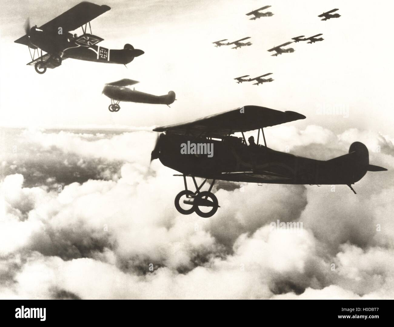 German biplanes flying above the clouds Stock Photo