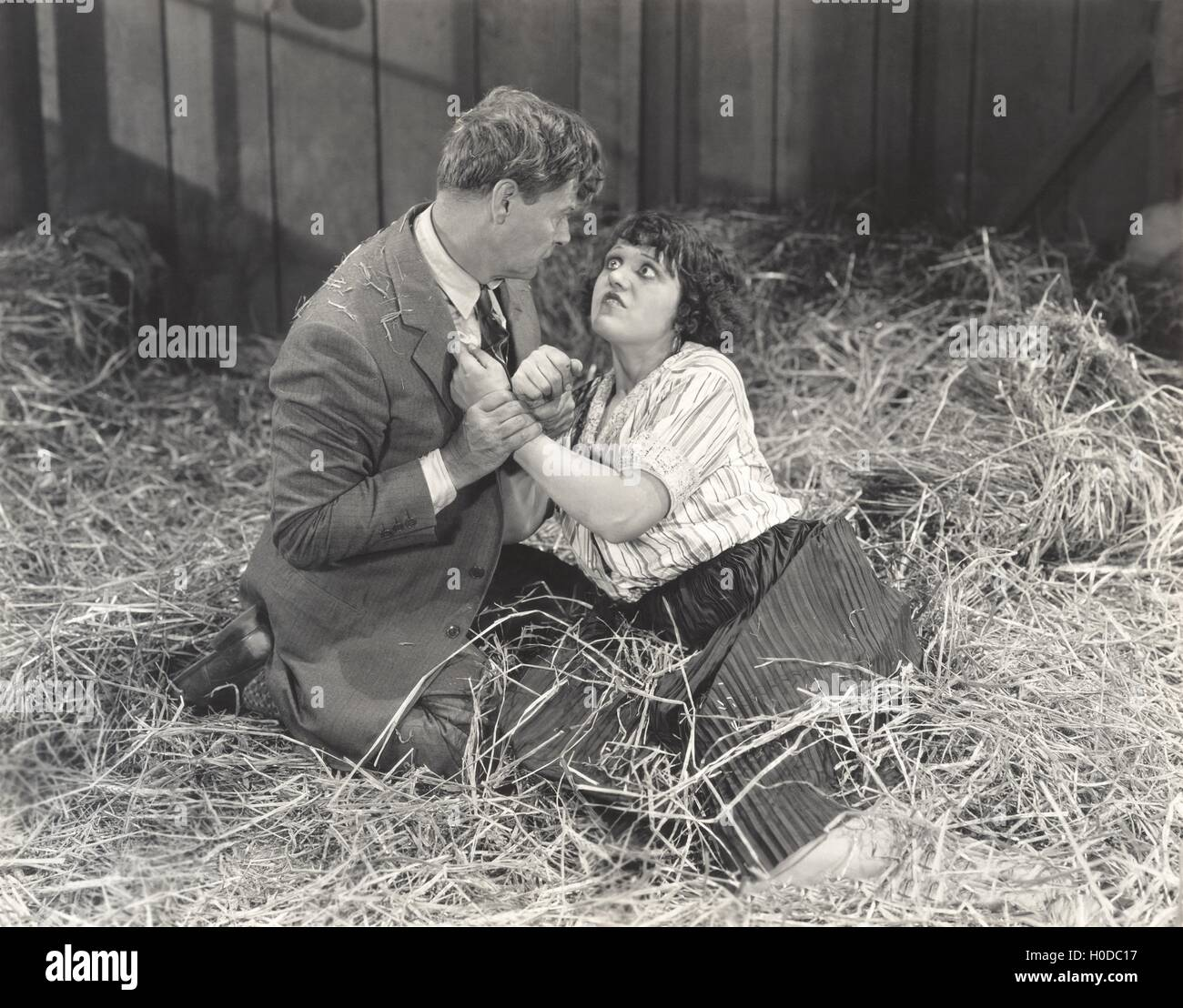 Couple fighting in barn - Stock Image