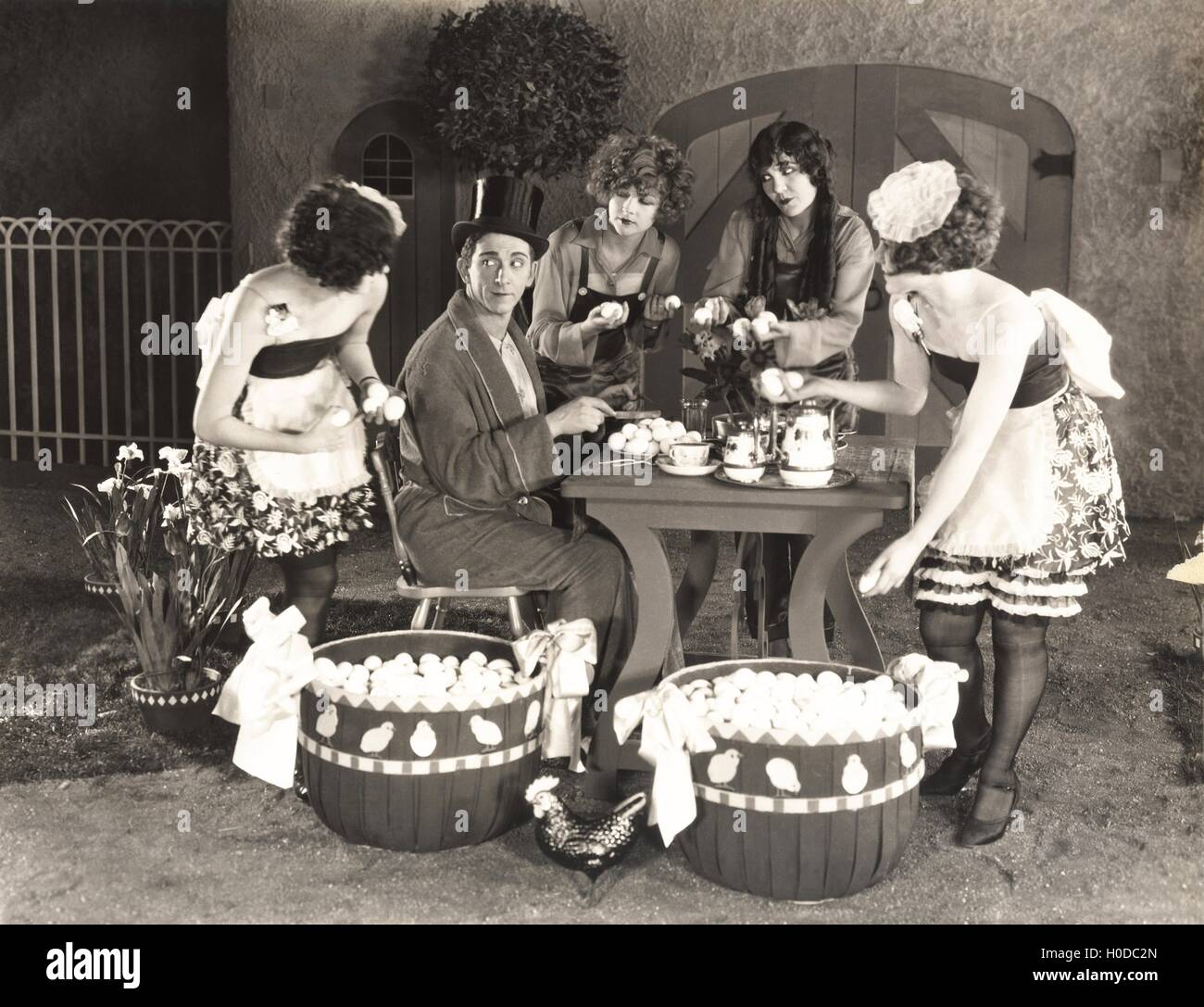 Young women offering an abundance of eggs to man - Stock Image
