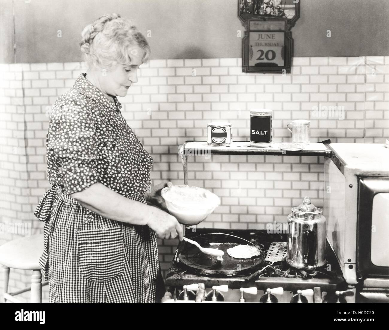 Making pancakes for breakfast - Stock Image