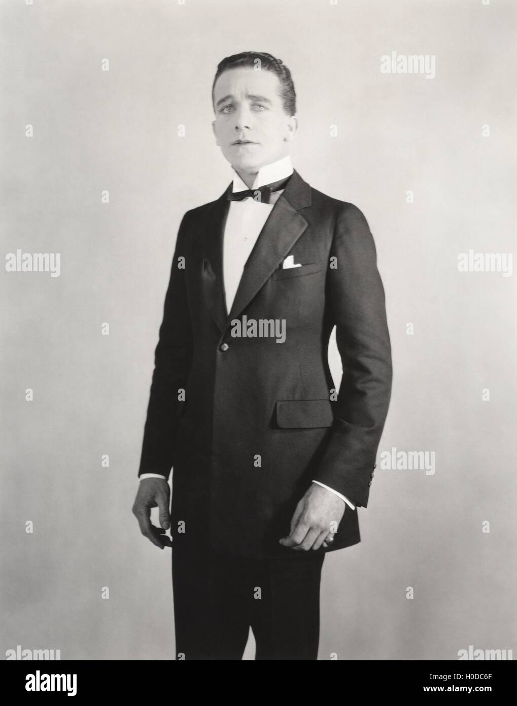 Man in formal white collar and tuxedo Stock Photo