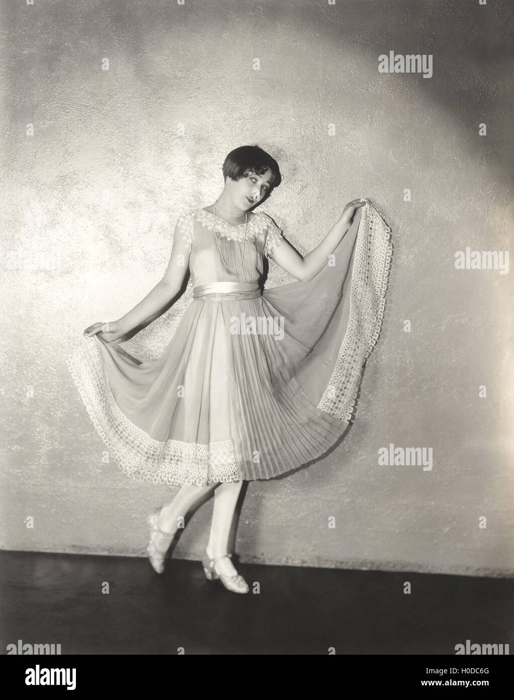 Woman modeling pleated dress - Stock Image