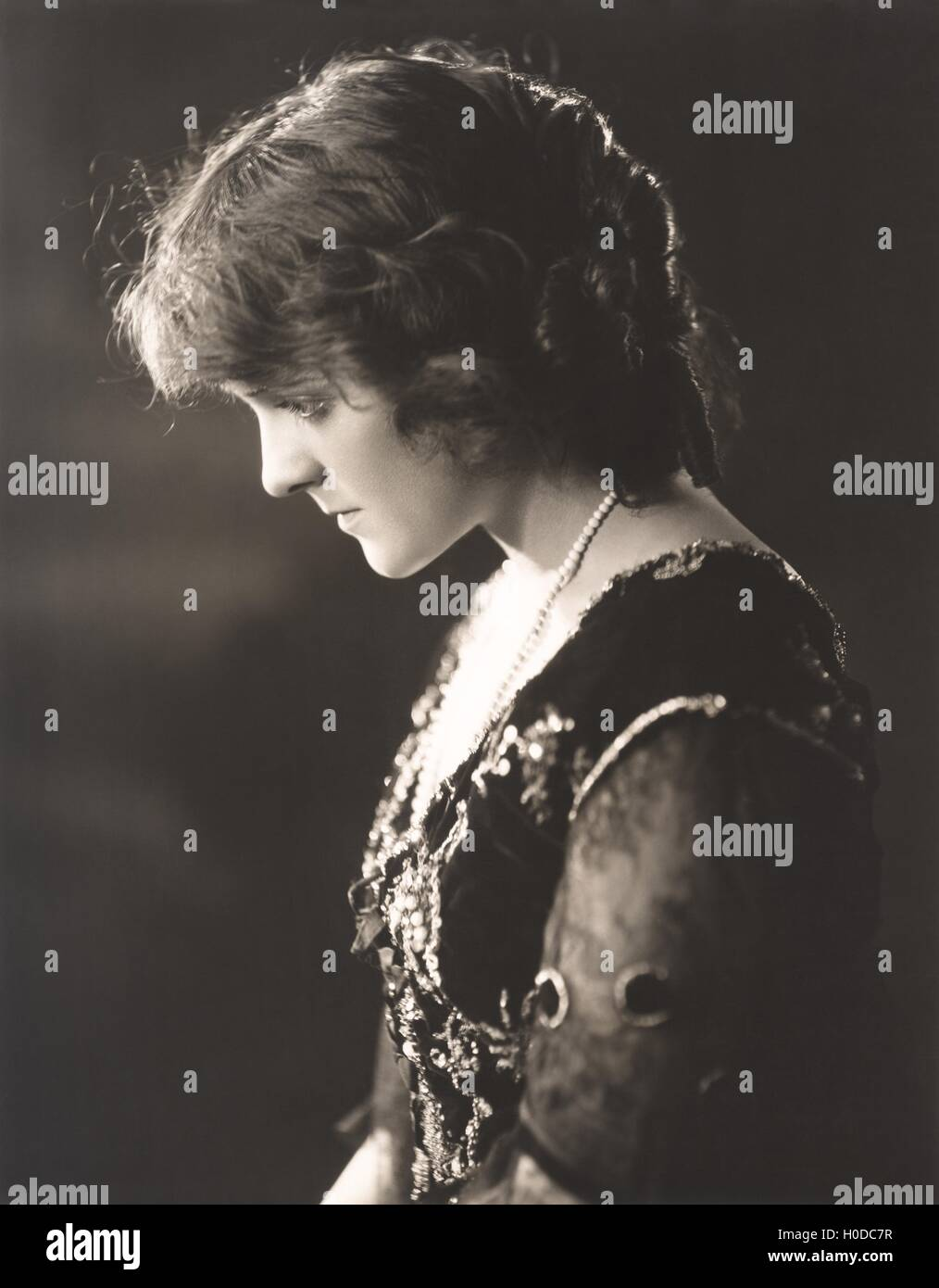 Portrait of a pensive woman - Stock Image