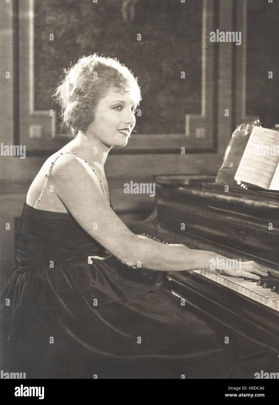 Woman playing piano - Stock Image