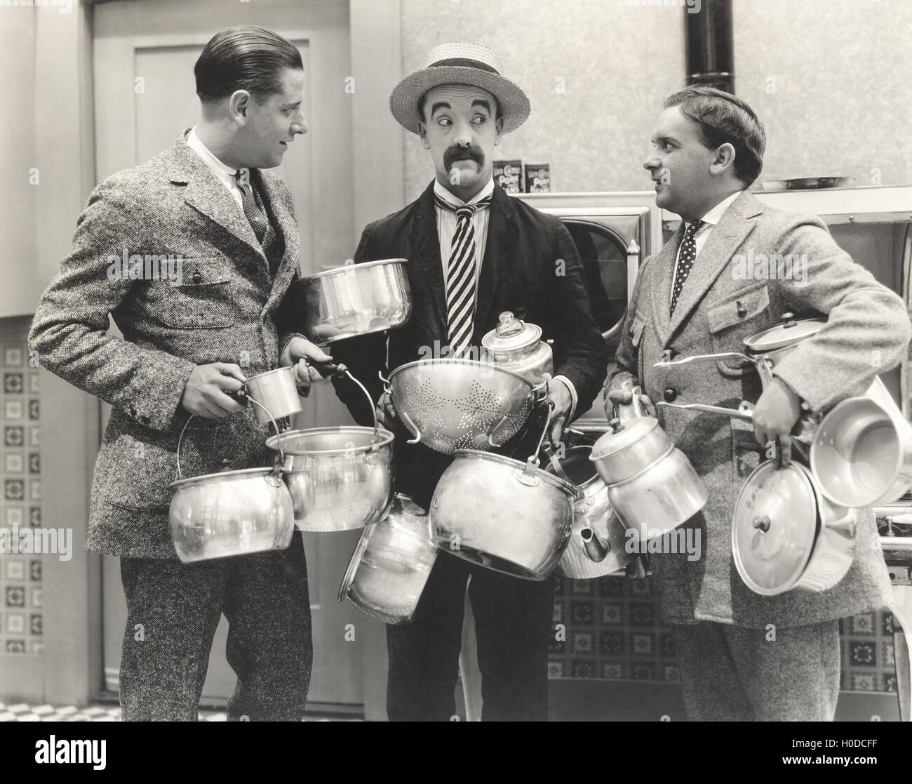 Men with lots of pots - Stock Image