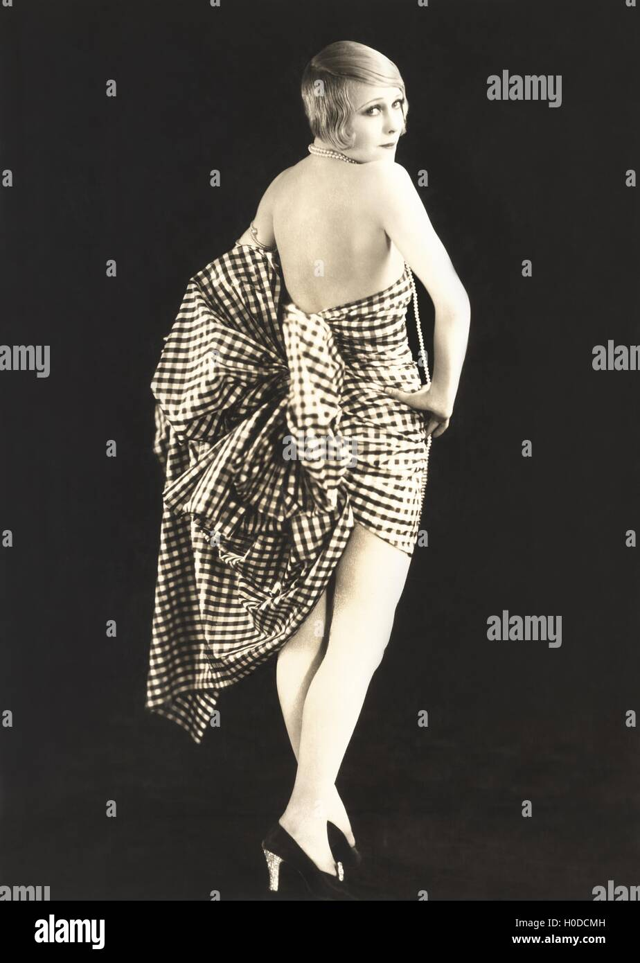 Woman dressed in gingham - Stock Image