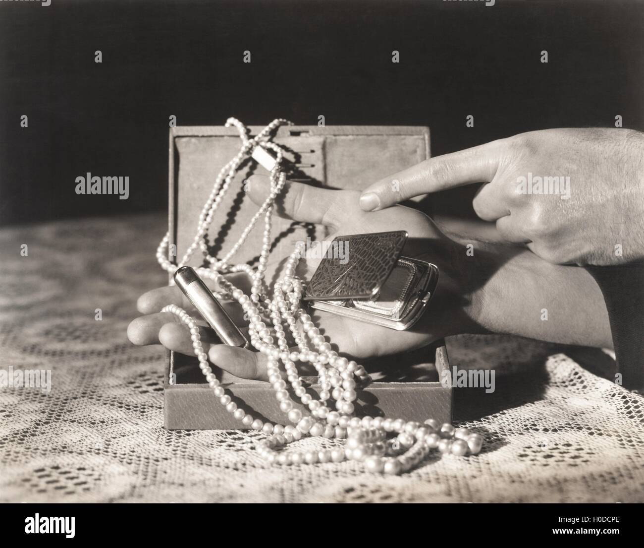 Finding the missing pearls - Stock Image