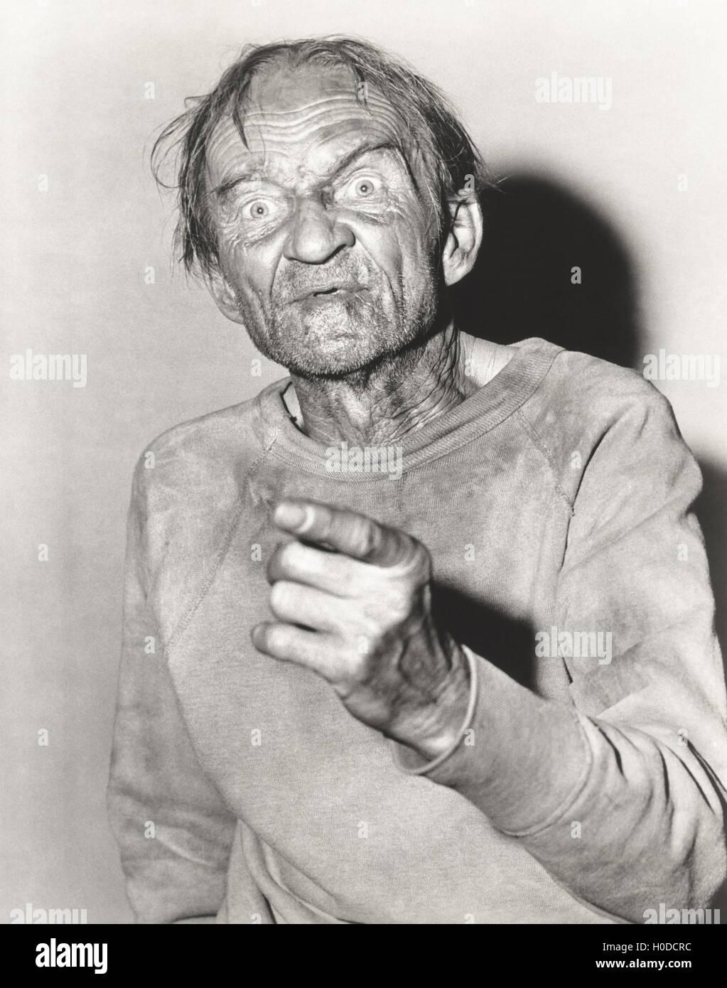 Elderly man pointing a finger - Stock Image