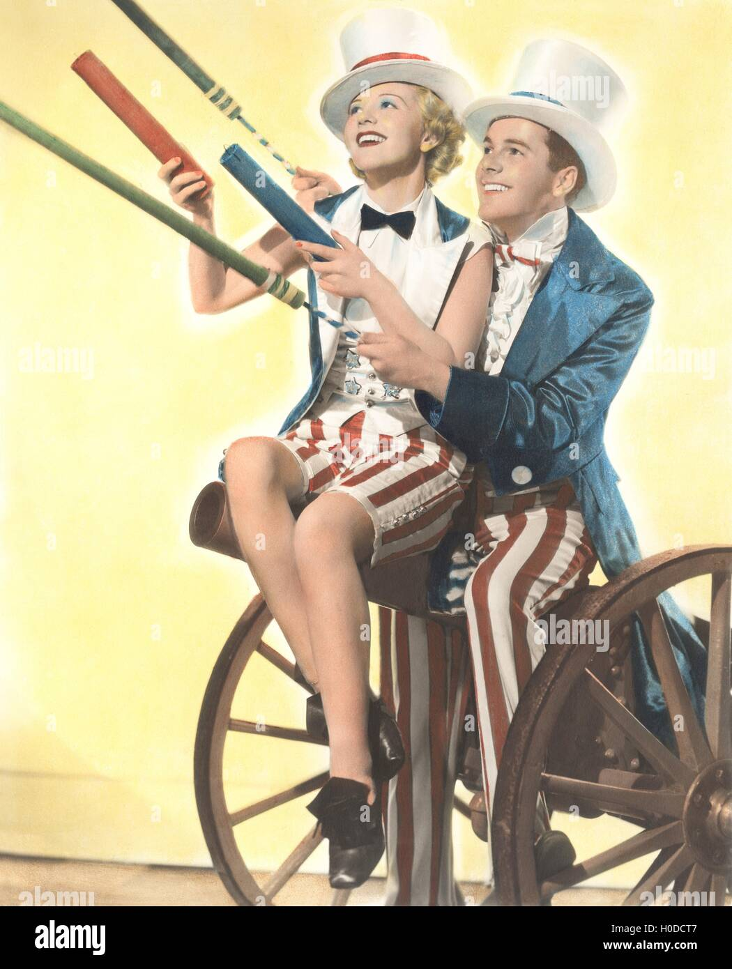 Two patriotic people with Roman candles celebrating July 4th - Stock Image