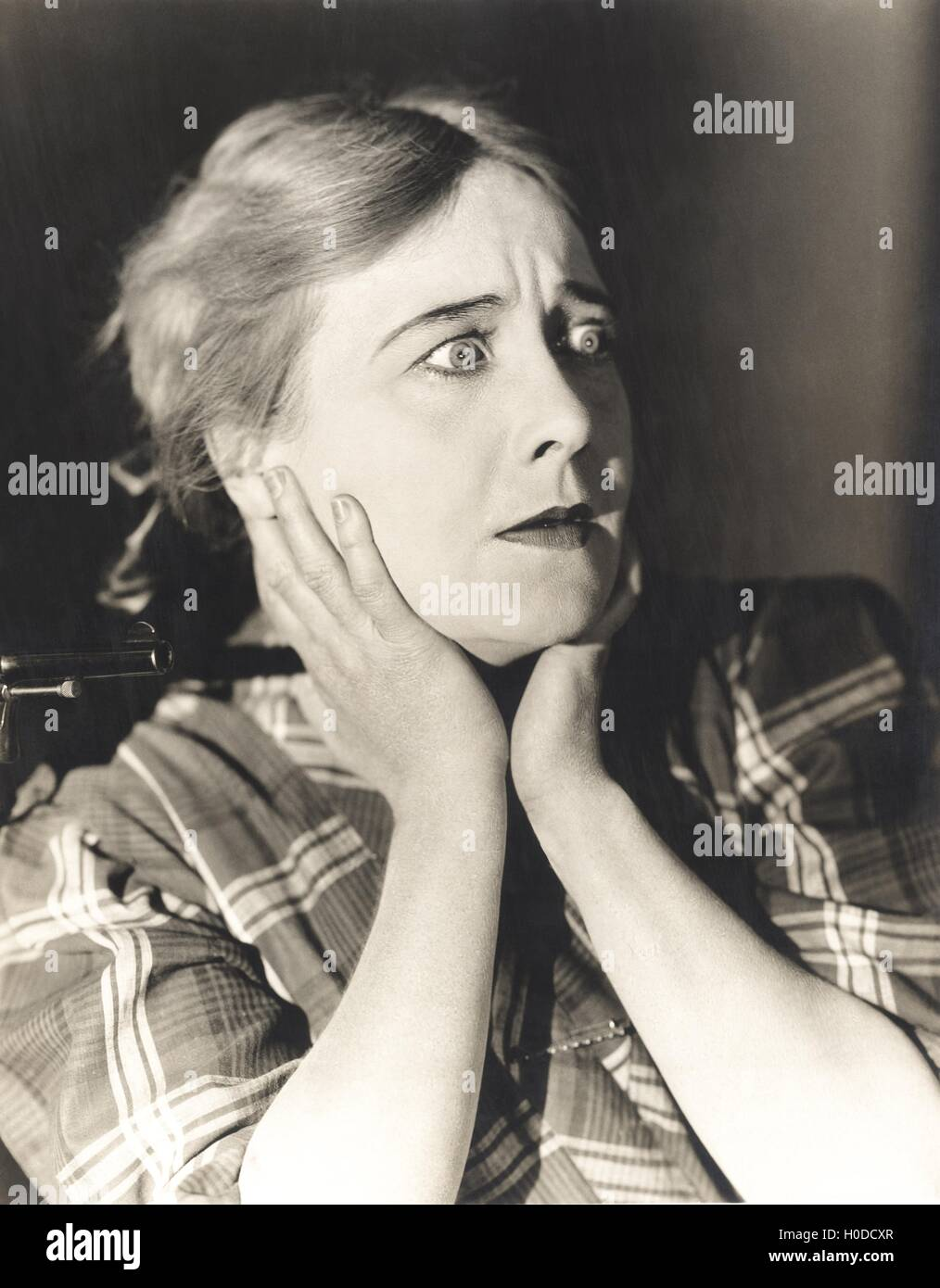 Woman in a state of shock - Stock Image