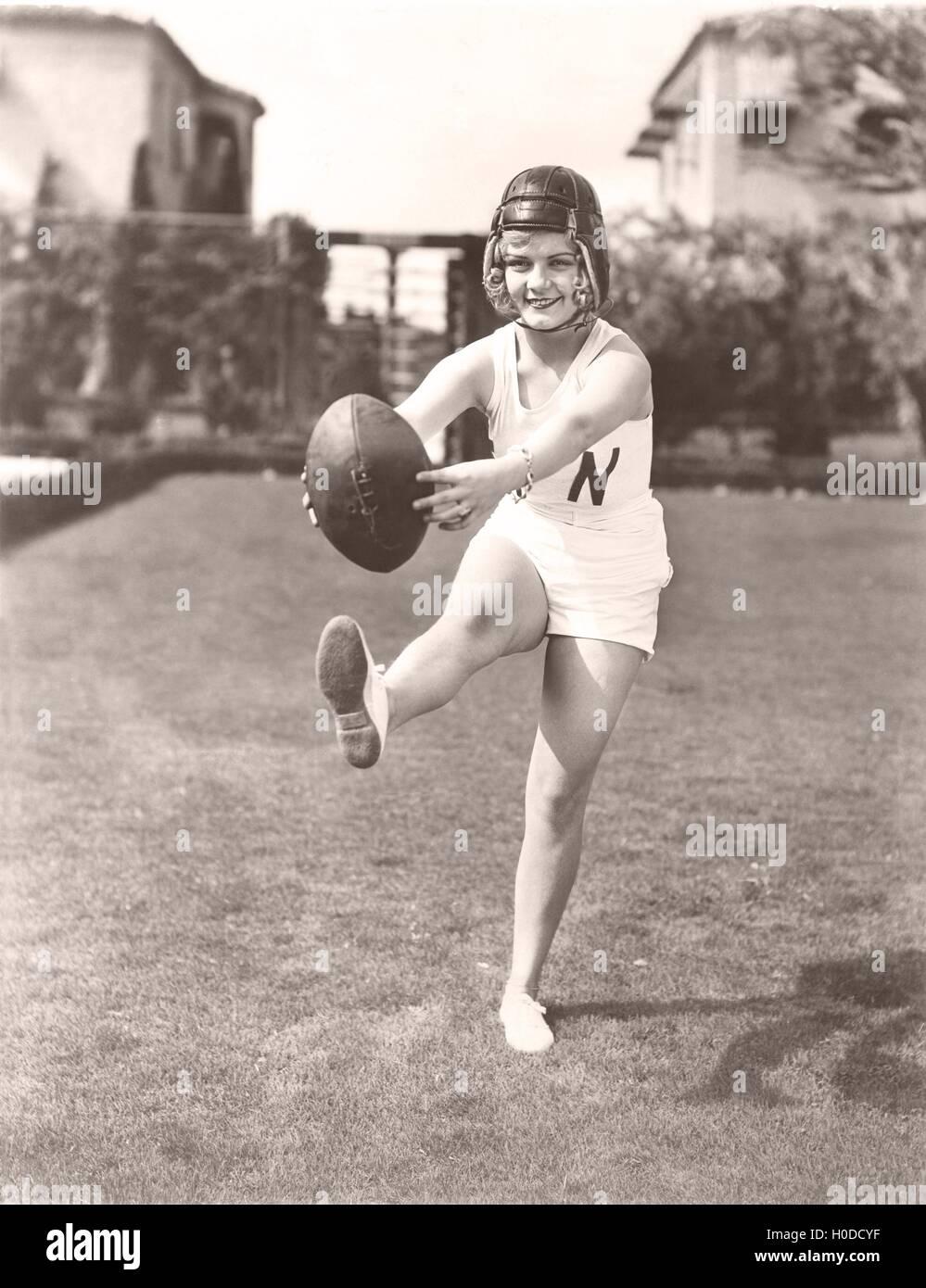 Woman playing football - Stock Image