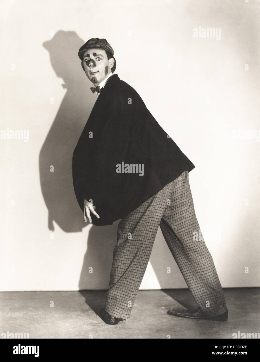 Man wearing rubber clown nose - Stock Image