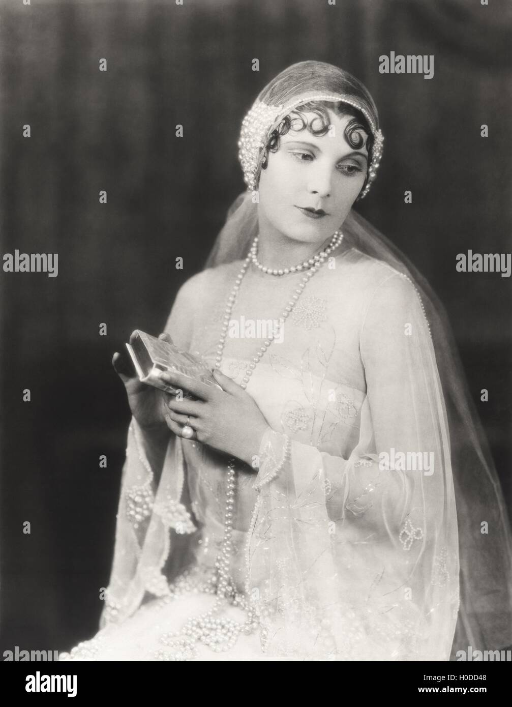 Bride holding clutch purse - Stock Image