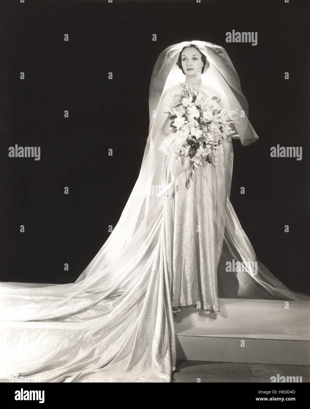 Bride wearing glittery wedding dress - Stock Image