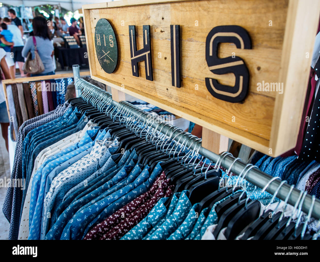Mens shirts on sale in a market stall Stock Photo