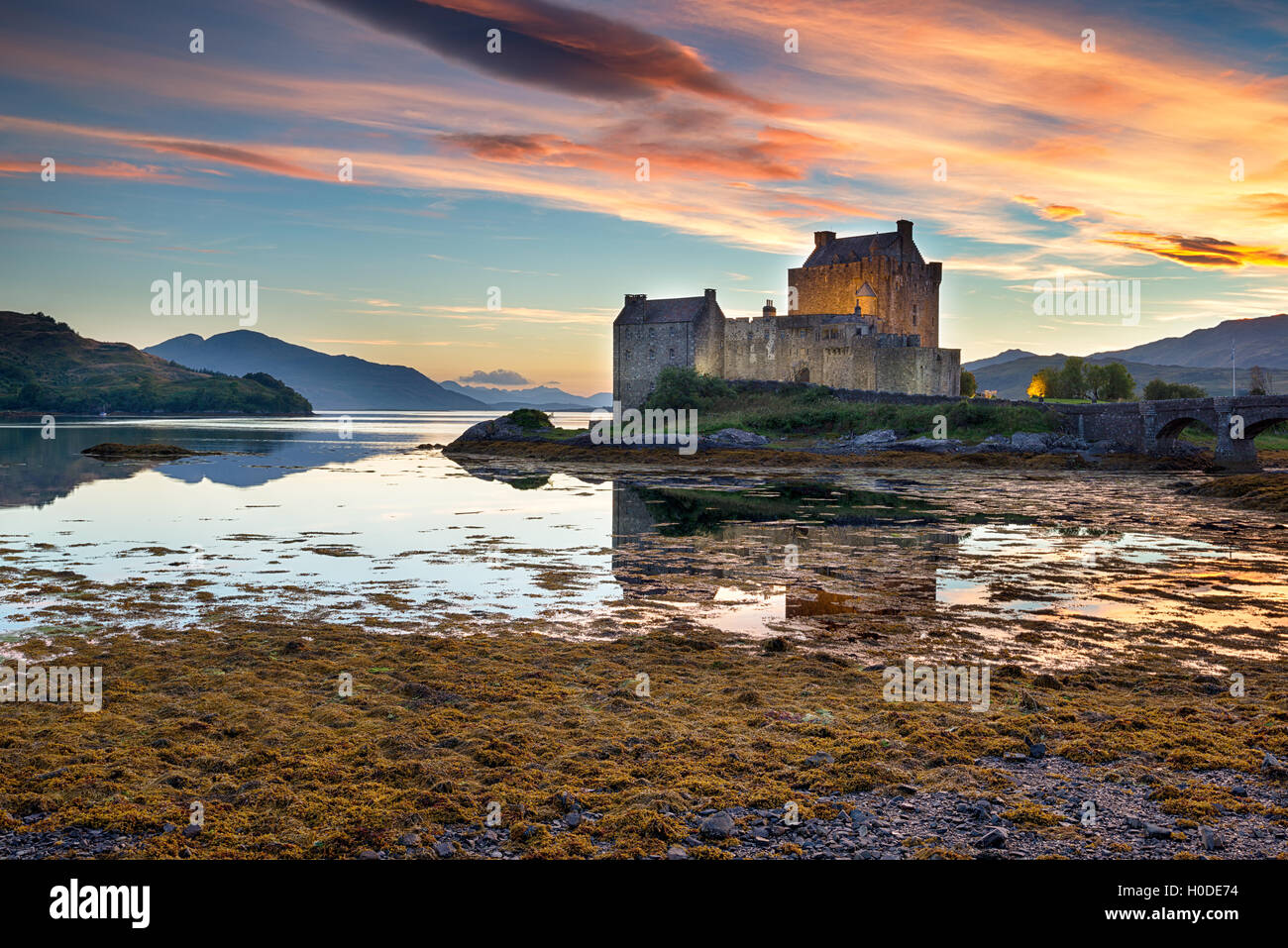 Beautiful sunset over the castle at Eilean Donan in the Scottish Highlands - Stock Image