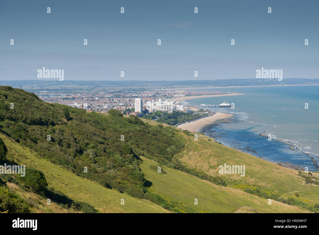 Town of Eastbourne, East Sussex, with chalk downland in the foreground. - Stock Image