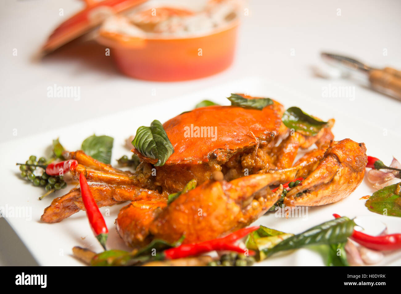 Wok fried crab with chilli and sweet Thai basil horizontal - Stock Image