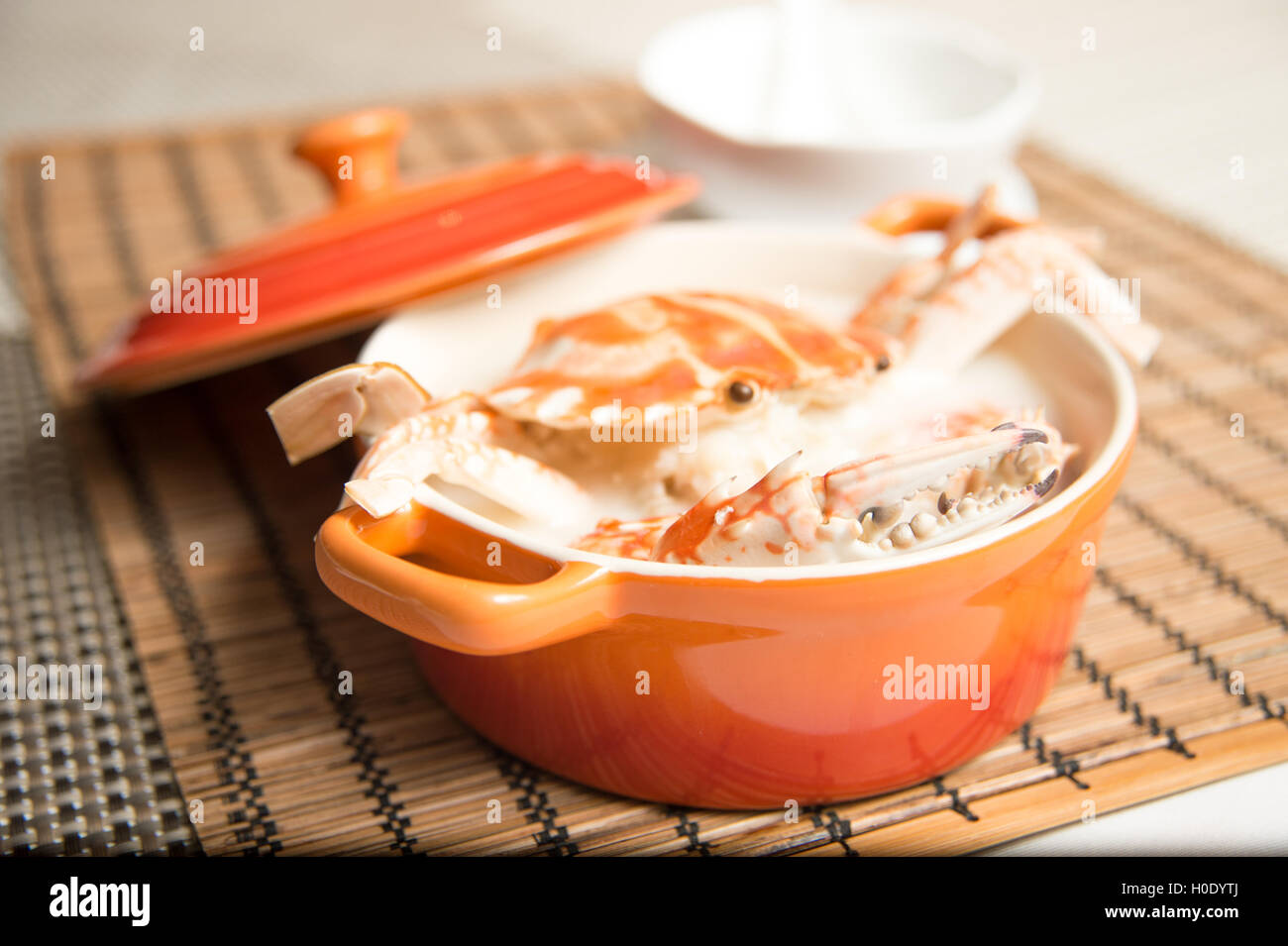 Female Crab Congee Horizontal in Chinese stew on bamboo tray - Stock Image