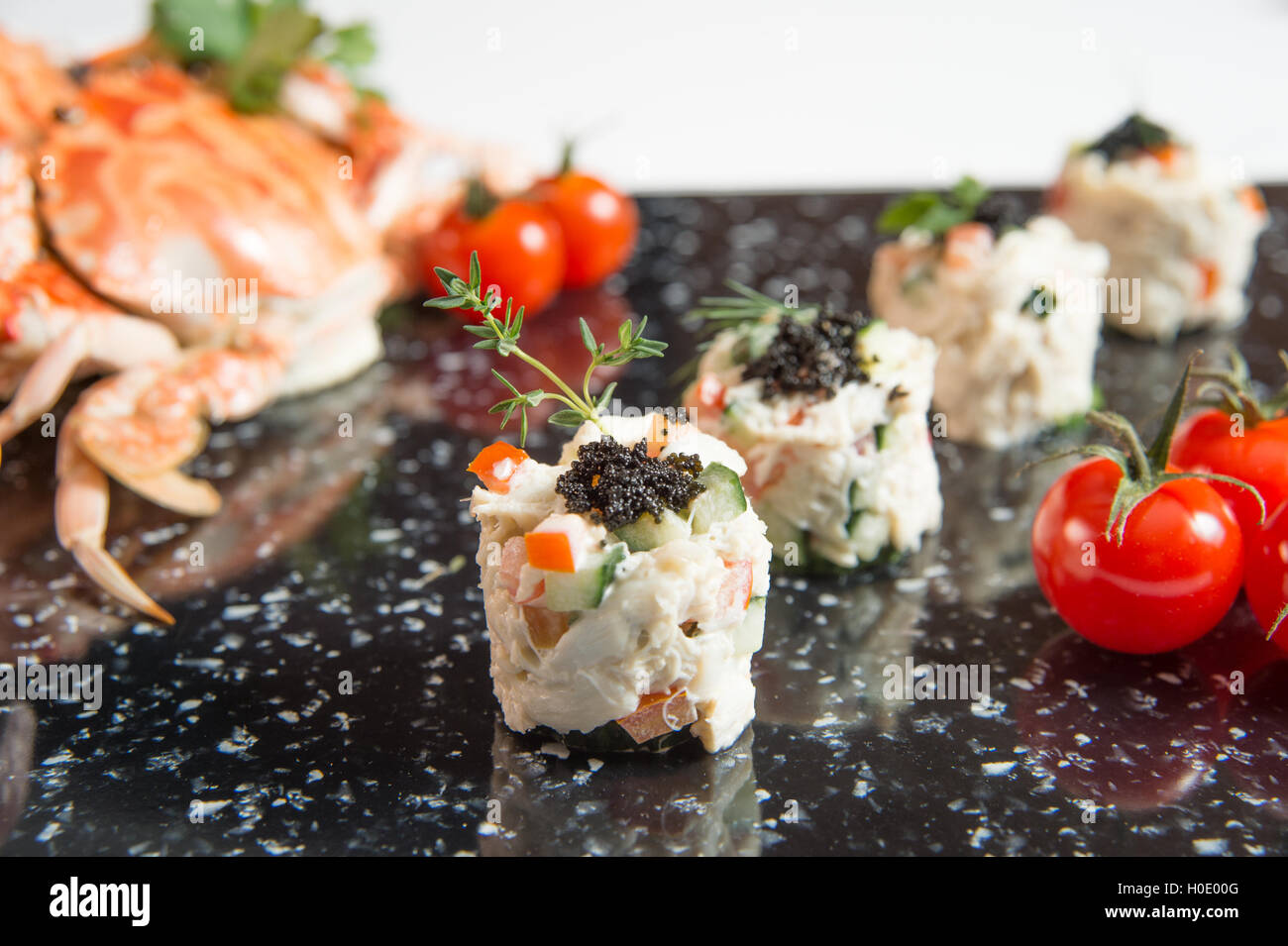 Crab Meat Salad with Black Caviar Horizontal tomato and crabs - Stock Image