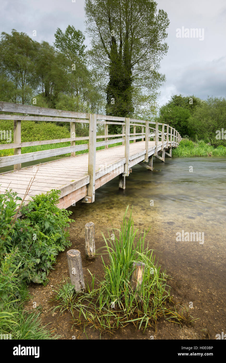 A footbridge for the Monarch's Way spanning the River Test at Houghton. Hampshire. England. UK - Stock Image