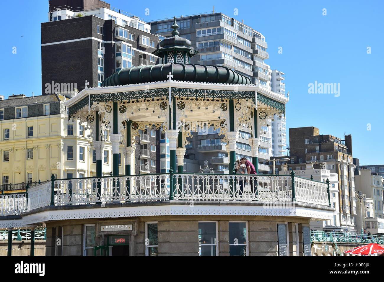 Couple kissing inside Brightons Bandstand - Stock Image