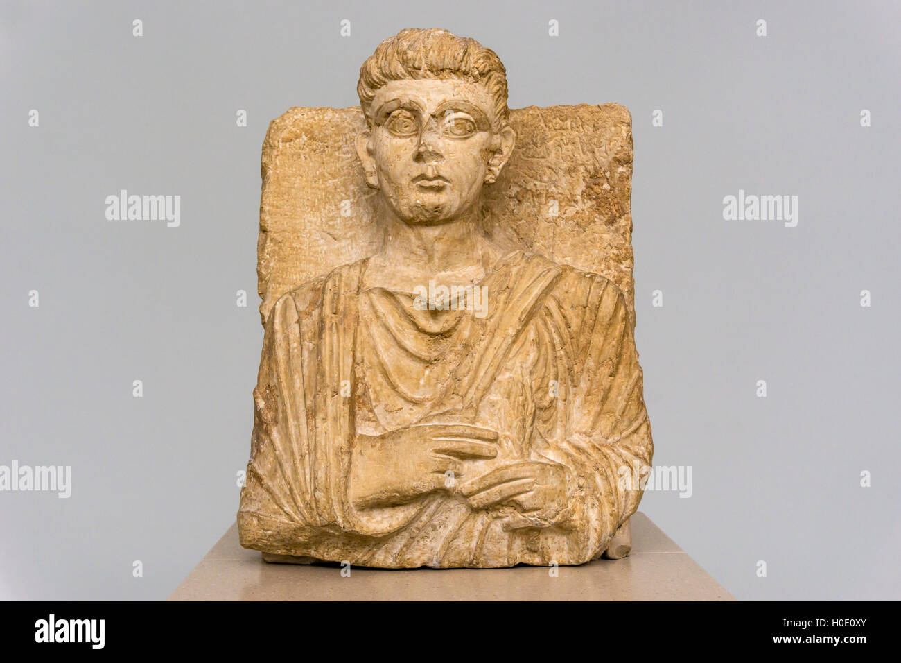 This statue is a funerary relief of a 2nd century inhabitant of Palmyra in Syria, identified only as Maliku. - Stock Image