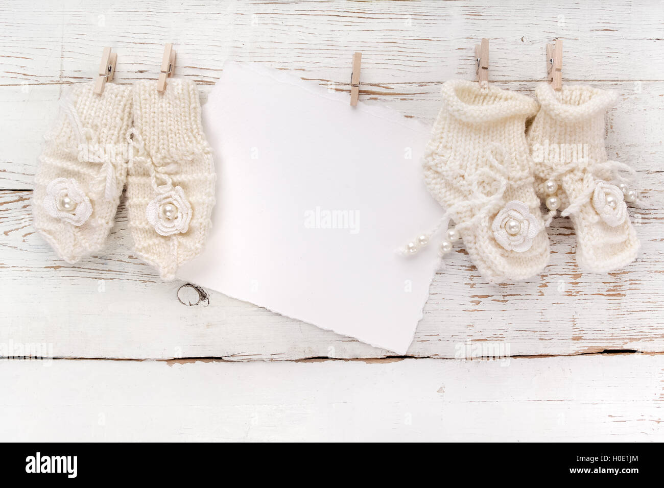 New born or baptism greeting card blank with baby girl shoes and new born or baptism greeting card blank with baby girl shoes and gloves on white wooden background m4hsunfo