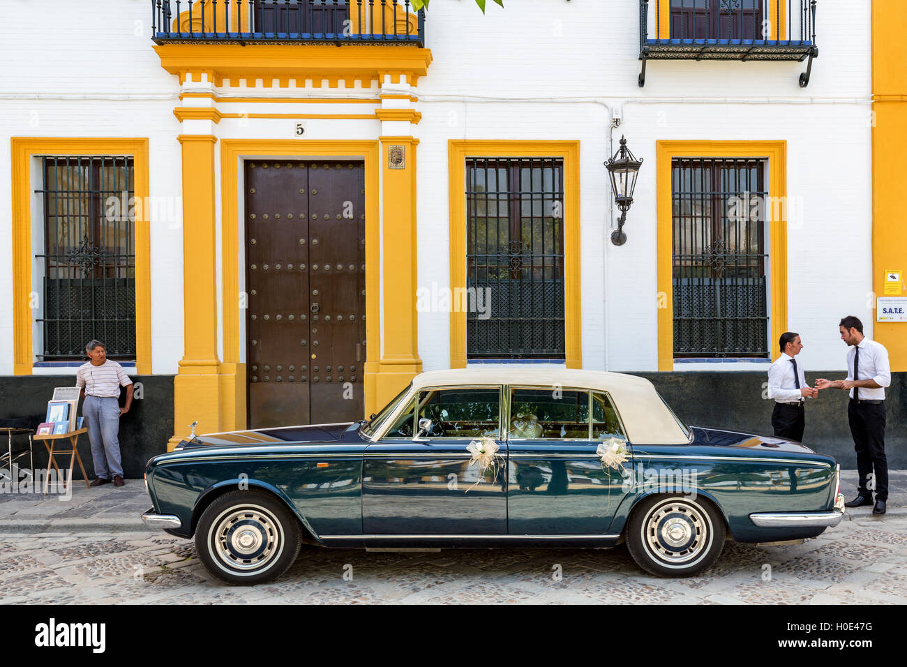 Street scene and a old car in Seville, Andalusia, Span - Stock Image
