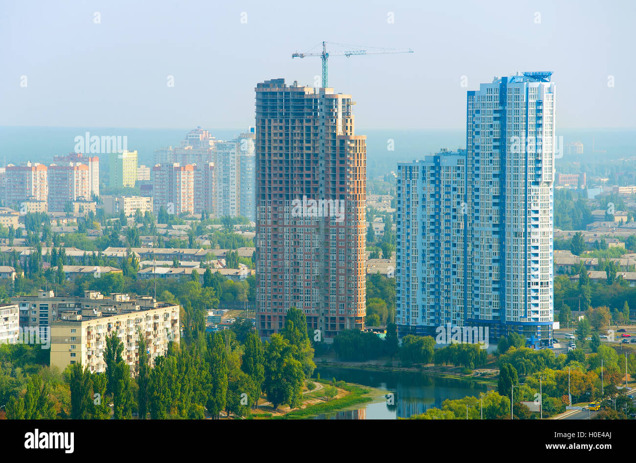Construction site of modern apartment building in the morning light - Stock Image