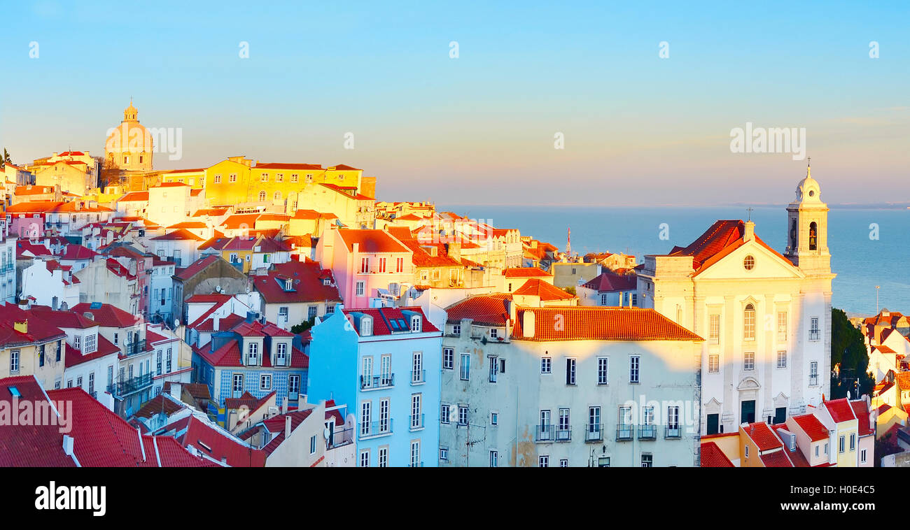 Sunset view of Alfama district - Old Town of Lisbon. Portugal - Stock Image