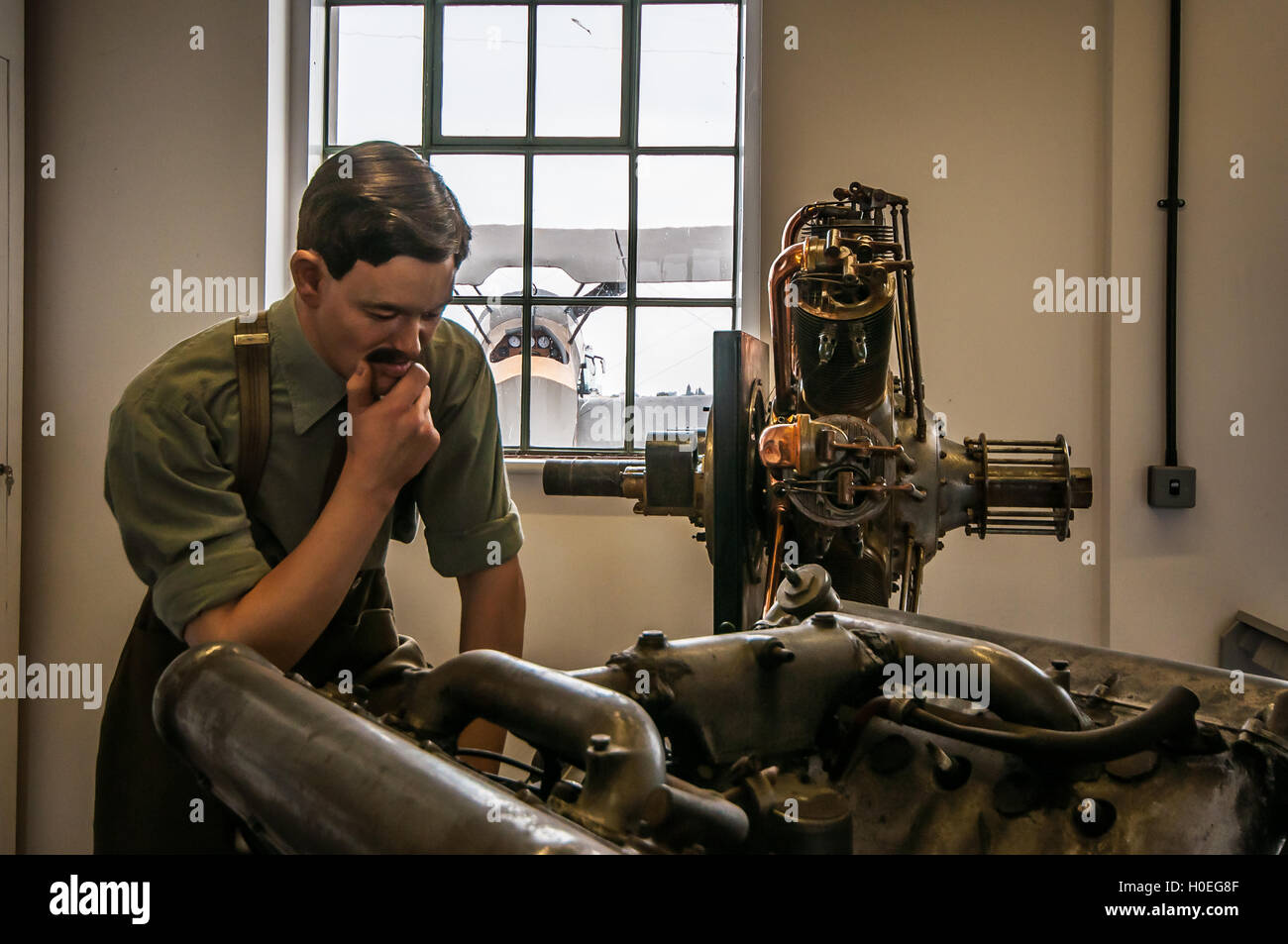 The Museum at the Stow Maries World War One Aerodrome in Essex, UK. An engineer mannequin studies an aircraft engine - Stock Image