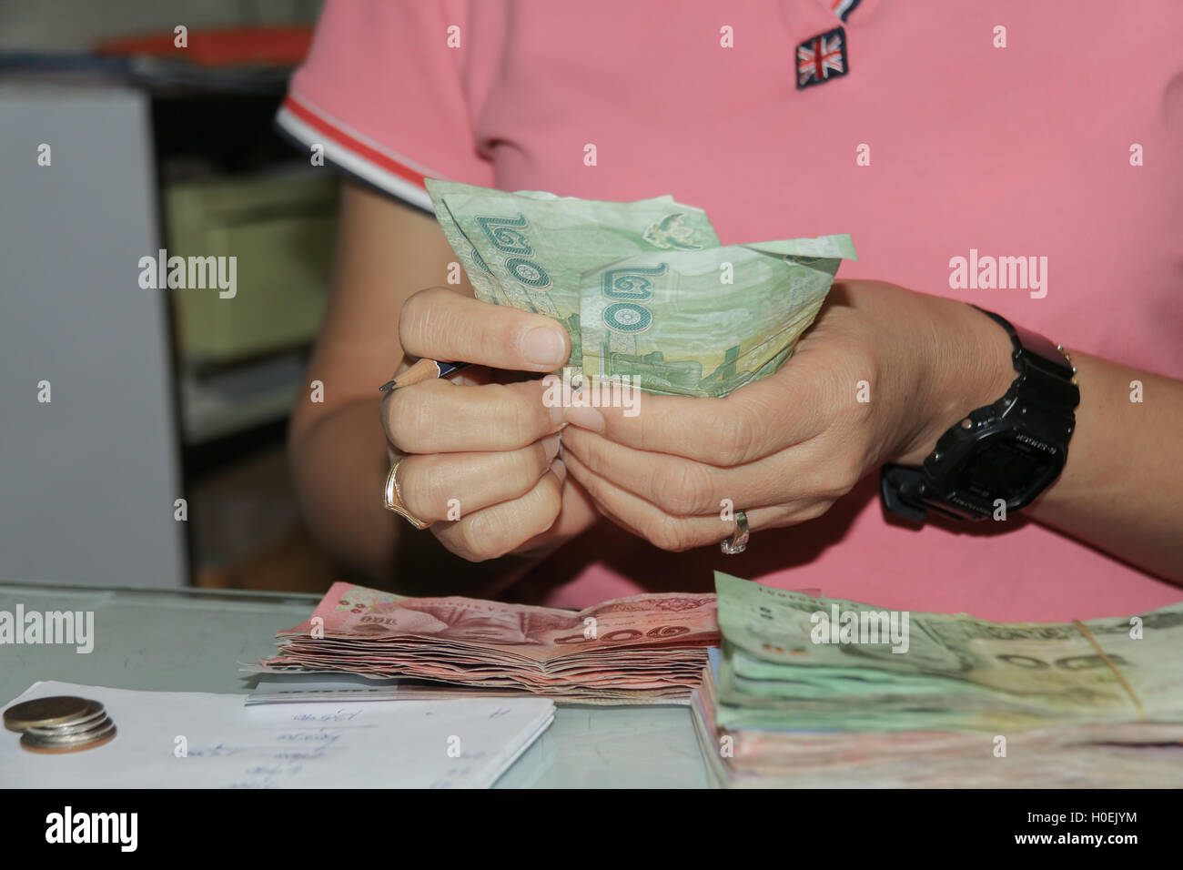 Asian woman counting Thailand Notes are represented on the exchange. This can be used to pay legal tender. - Stock Image