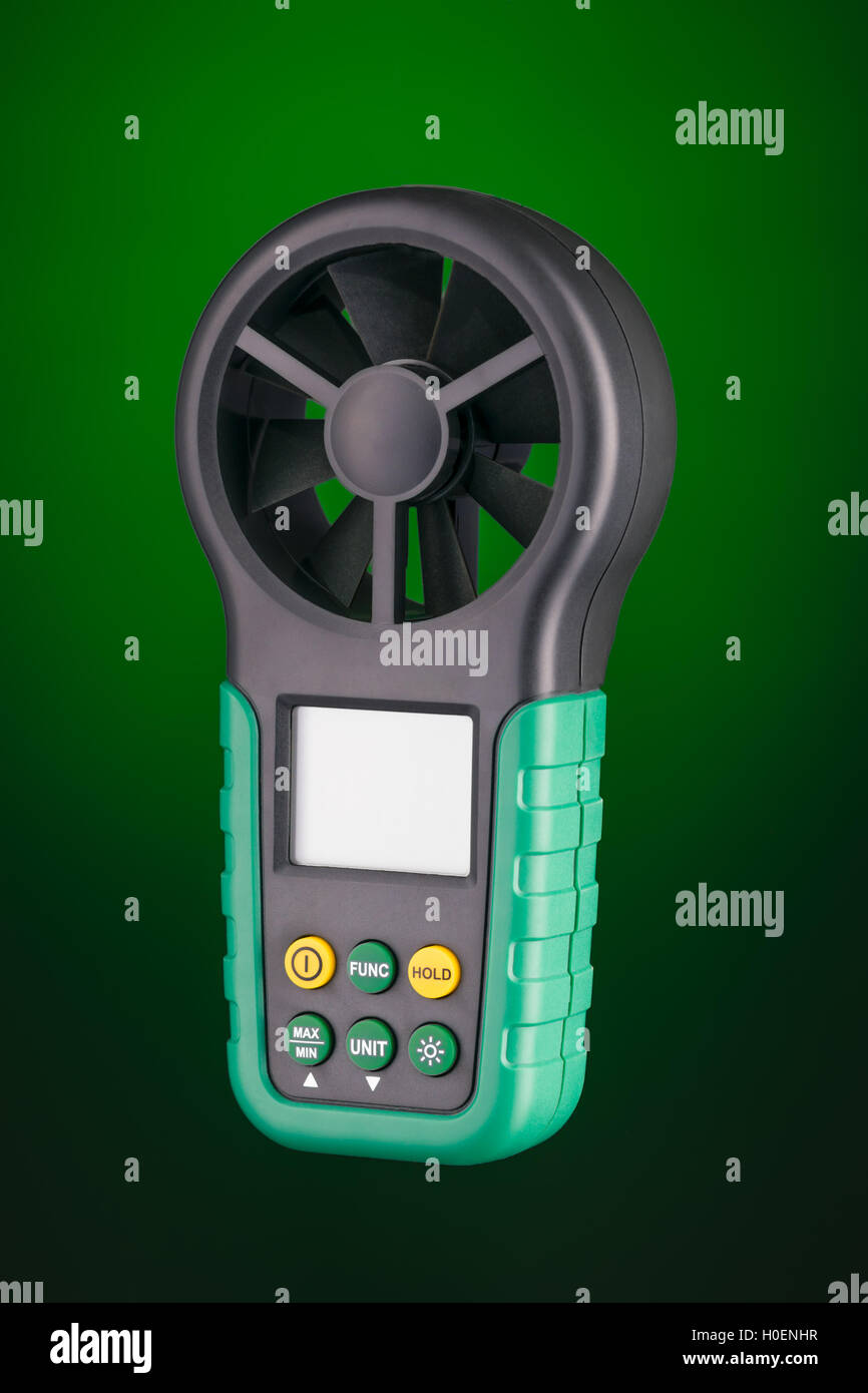 Digital handheld anemometer 3/4 view  isolated on green background - Stock Image