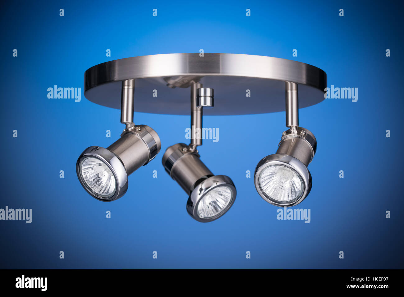 Ceiling light fixture isolated on blue background - Stock Image