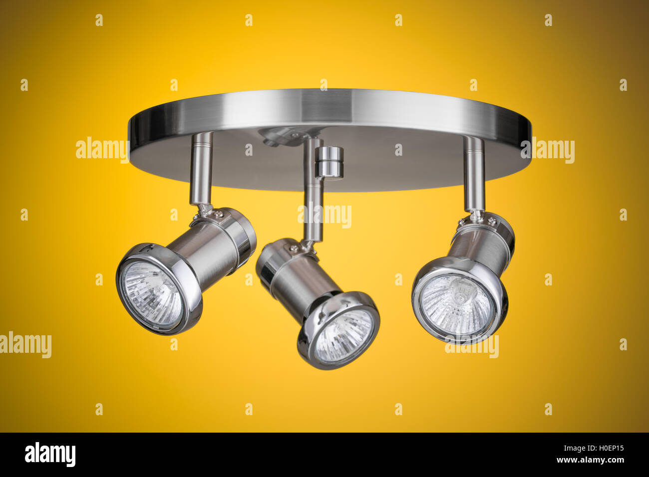 Ceiling light fixture isolated on yellow background - Stock Image