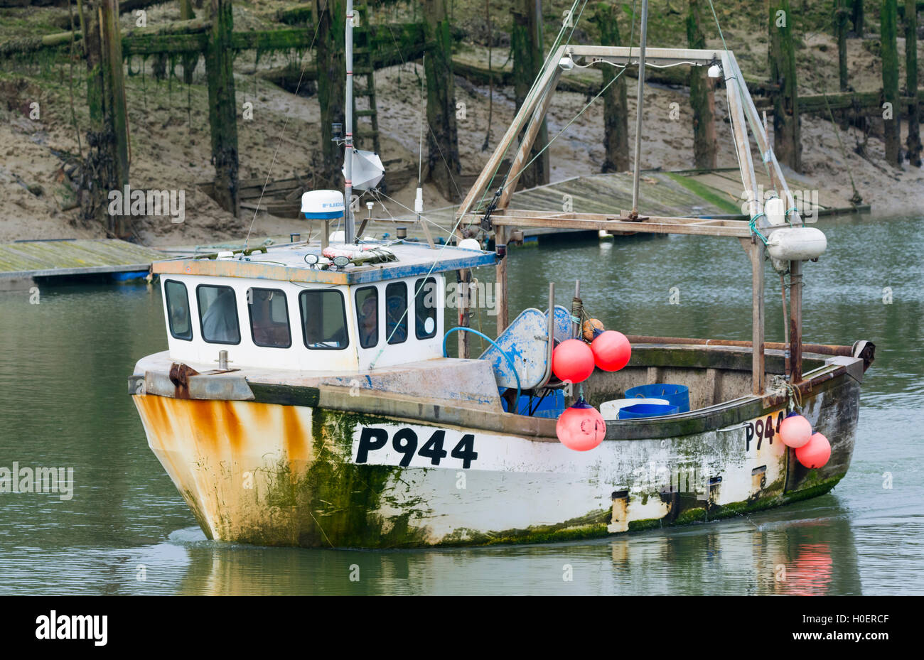 Rusty old fishing boat on a river estuary. - Stock Image