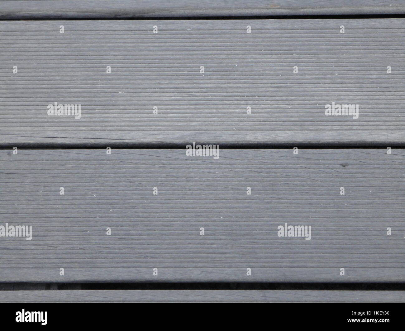 detail shot of horizontal planks of wood, texture, pattern, monochrome, light colours - Stock Image